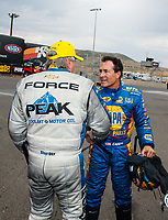 Jul 22, 2018; Morrison, CO, USA; NHRA funny car driver John Force (left) is congratulated by Ron Capps as he celebrates after winning the Mile High Nationals at Bandimere Speedway. Mandatory Credit: Mark J. Rebilas-USA TODAY Sports