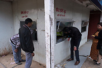 People talk to the police in a security booth near HUDA City Centre in Gurugram, Haryana, India, on Mon., December 10, 2018.