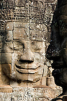 Two of the nearly 200 massive faces carved into the towers and walls of the Bayon, in the Angkor temple complex of Cambodia. This temple, one of the most impressive religious constructions in the world, was started by the Khmer Emperor Jayavarman VII in the early 13th century and some scholars think that the faces are representations of him. Others say that they belong to the boddhisattva of compassion called Avalokitesvara or Lokesvara.