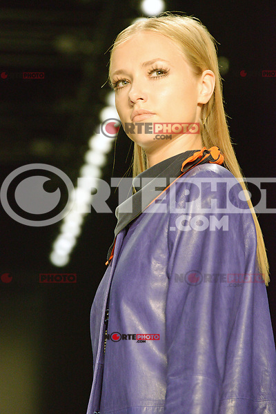 A model walks the runway at the BLACKY DRESS fashion show during the Mercedes-Benz Fashion Week Berlin in Berlin 06.07.2012. Credit: Timm/face to face /MediaPunch Inc. ***FOR USA ONLY*** ***Online Only for USA Weekly Print Magazines***