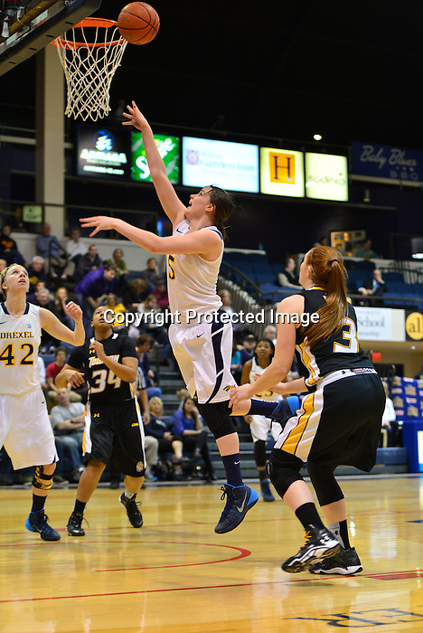 PHILADELPHIA &ndash; Before the season started, a young Drexel women's basketball team set a goal for itself to finish the regular season in the top four in the Colonial Athletic Association. Coming into play on Wednesday night, the Dragons needed a win to achieve that goal. Drexel wasted no time jumping on top of Towson on Senior Night, rolling to an 82-40 victory that locked up the No. 4 seed in the upcoming CAA Tournament.<br /> <br /> Carrie Alexander had a career high by halftime as Drexel set season highs with 42 points on 19-of-26 shooting (73.1 percent) in the first half. She finished with 14 points, matching senior Tory Thierolf for the team-high. Rachel Pearson added 12 points, going 4-for-4 from long range in the second half. Jackie Schluth added 10 points, matching her career high on 5-of-6 shooting.<br /> <br /> Senior Fiona Flanagan added nine points, hitting her first three treys of the night and finishing 3-for-4. She also had five assists and no turnovers. In all, nine different Dragons scored on the evening, with seven of them netting at least eight points. Meghan Creighton added six assists to her eight points, a team high as the Dragons dished out 27 helpers on the evening. Sarah Curran also had eight points to go along with a career-high four assists. Senior Abby Redick finished with two points, three rebounds and two assists.<br /> <br /> Drexel finished shooting a season-best 64.7 percent from the floor, hitting 33 of 51 attempts. The Dragons were also 10-for-17 from long range, including a 7-for-12 mark in the second half.<br /> <br /> The Dragons did not trail after allowing the Tigers to score the game's first points, putting Towson on top 2-0. Thierolf netted the next four for the Dragons, followed by a three-ball by Flanagan.<br /> <br /> By the 11:26 mark of the first half, Drexel was up by double digits after another trey from the senior out of Penn Valley, Pa. Flanagan has now hit 121 of her 299 career three-point attempts, good for a 