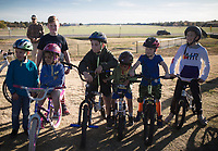 NWA Democrat-Gazette/CHARLIE KAIJO Kids watch as riders from All Bikes All Day NWA perform tricks, Sunday, November 3, 2019 during the Runway Bike Park's first birthday celebration at the Jones Center's Runway Bike Park in Springdale.<br /> <br /> Riders took to the pump track and bicycle playground to celebrate along with community bike groups Buddy Pegs, Groove Skate Shop and All Bikes All Day NWA