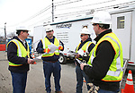 First Energy Safety Officer Paul Dindo (2nd Left) explains safety procedures to West Penn Power Employees at the First Energy Mobile Command Center at the Sussex County Fairgrounds JCP&L Staging Site in Augusta, New Jersey
