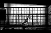 Wroclaw 24.05.2006 Poland<br /> The worst and the most dangerous district in Wroclaw ( Poland ) , called by people &quot;The Bermuda Triangle&quot;. There are walls bearing an inscription &quot;Who will enter here, will not exit alive&quot; Many families there are pathological and live in extreme poverty. Children have no place for any games so they loaf around on this wasted district and disseminate a juvenile delinquency. Many of them become sexually active though they are only 10-12 years old<br /> (Photo by Adam Lach / Napo Images)<br /> <br /> Najbardziej nabezpieczna dzielnica we Wroclawiu zwana przez ludzi Trojkatem Bermudzkim. Sa tam sciany opatrzone napisem &quot; Kto tu wejdzie, nigdy nie wyjdzie stad zywy&quot; Mieszka tam wiele rodzin patologicznych i zyja w wielkiej nedzy. Dzieci wlocza sie po ulicach nie majac miejsc na zabawe i szerza przestepczosc wsrod nieletnich. Wiele z dzieci uprawia seks choc maja zaledwie 10-12 lat<br /> (Fot Adam Lach / Napo Images)