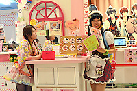 Young female waitress in waiting to serve customers at Maid care in Harajuku, Tokyo