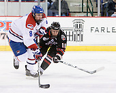 Colin Wright (Lowell - 8), Mike McLaughlin (Northeastern - 18) - The visiting Northeastern University Huskies defeated the University of Massachusetts-Lowell River Hawks 3-2 with 14 seconds remaining in overtime on Friday, February 11, 2011, at Tsongas Arena in Lowelll, Massachusetts.