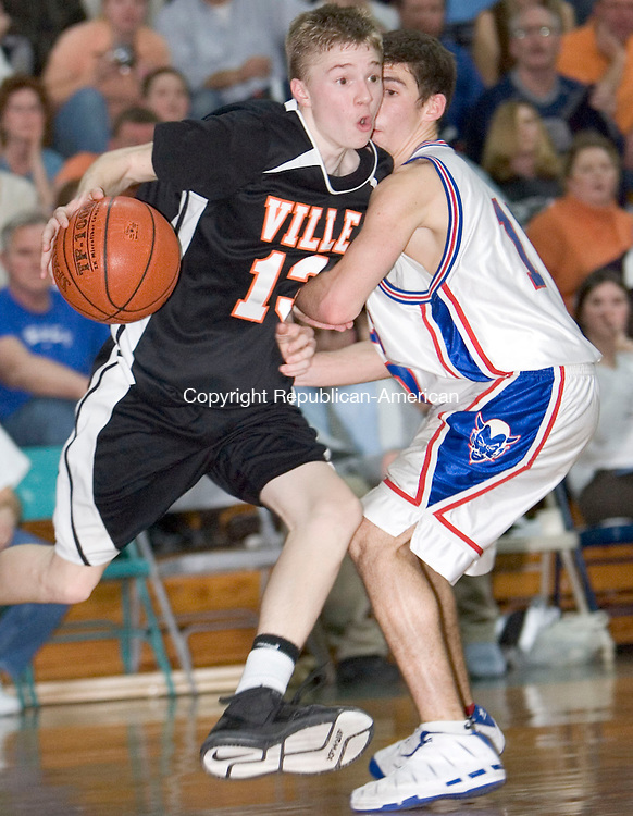 ROCKY HILL, CT- 13 MARCH 07- 031207JT10- <br /> Terryville's Mike Garrow dribbles past Coginchaug's Mark Sutterlin during Monday's Class S quarterfinal game at Rocky Hill High School. Terryville lost 70-58.<br /> Josalee Thrift Republican-American