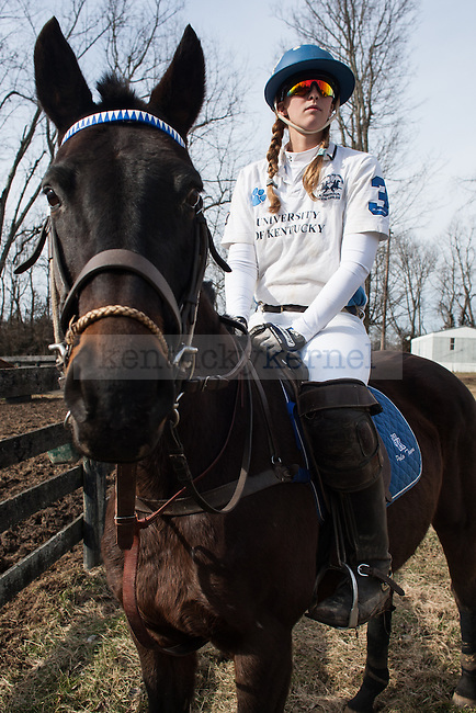 Emma Oakley sits atop one of the horses used for polo matches at West Wind Stables on Saturday, January 31, 2015 in Lexington, Ky. Photo by Adam Pennavaria | Staff