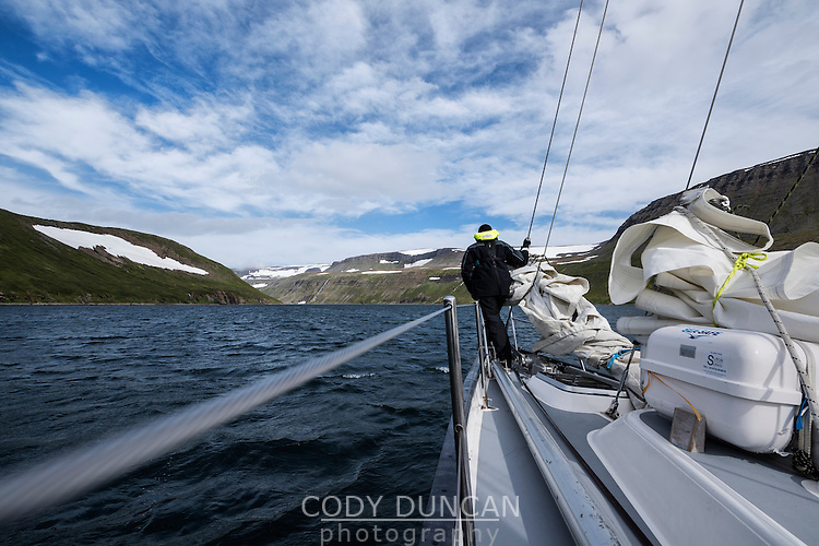 Sailing into a fjord in the Hornstrandir peninsula, Westfjords, Iceland