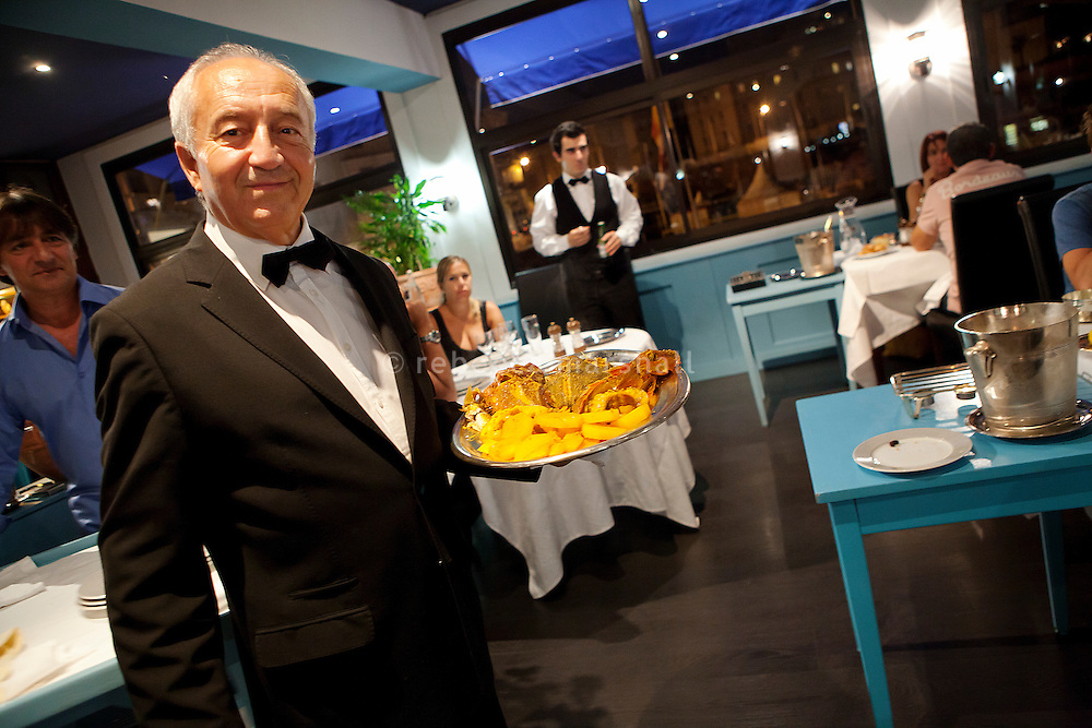 Jean Marchi, maître d'hôtel of restaurant 'Le Calypso', serves a bouillabaisse in the dining room of Le Calypso, Marseille, France, 25 August 2012. Jean has worked at Le Calypso for 36 years.