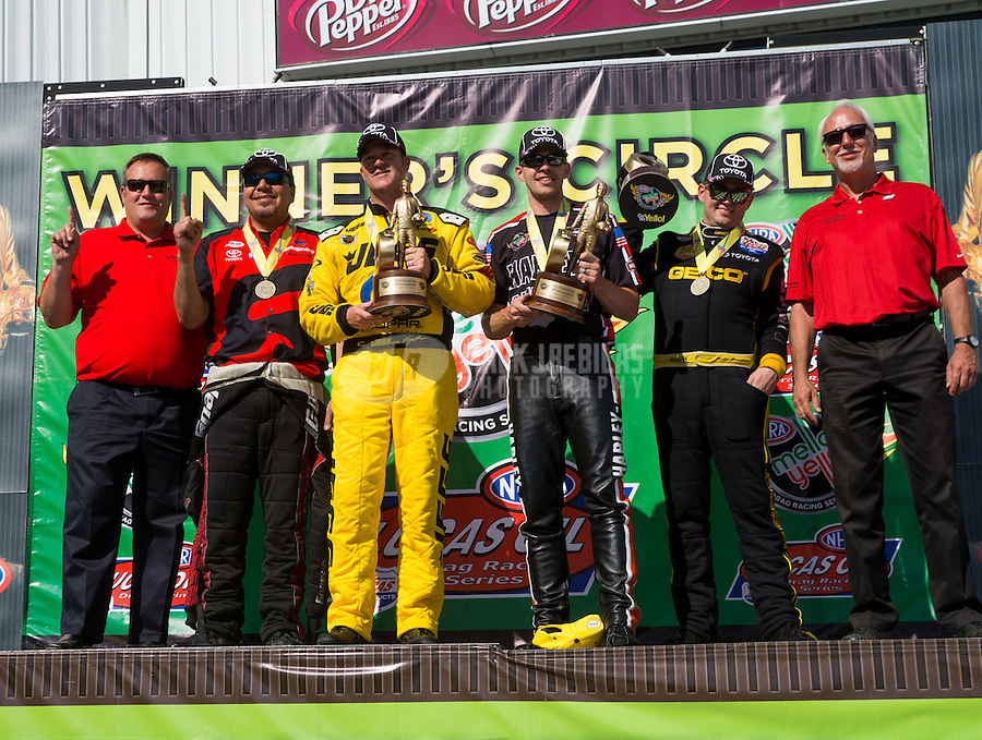 Jun. 1, 2014; Englishtown, NJ, USA; (from right to left) NHRA top fuel driver Richie Crampton , pro stock motorcycle rider Andrew Hines , pro stock driver Jeg Coughlin jr and funny car driver Cruz Pedregon are flanked by Toyota Racing officials as they celebrate on the podium after winning the Summernationals at Raceway Park. Mandatory Credit: Mark J. Rebilas-