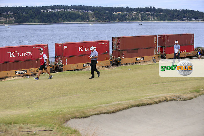 Phil MICKELSON (USA) and Bubba Watson (USA) on the 16th green as a freight train passes by in the background during Thursday's Round 1 of the 2015 U.S. Open 115th National Championship held at Chambers Bay, Seattle, Washington, USA. 6/18/2015.<br /> Picture: Golffile | Eoin Clarke<br /> <br /> <br /> <br /> <br /> All photo usage must carry mandatory copyright credit (&copy; Golffile | Eoin Clarke)