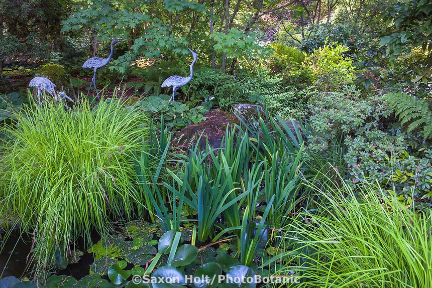 Three Cranes sculpture by pond in Shorts Ground Cover Garden at Bellevue Botanical Garden