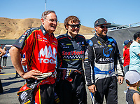 Jul 30, 2017; Sonoma, CA, USA; NHRA top fuel driver Doug Kalitta (left) with teammates Troy Coughlin Jr (center) and Shawn Langdon during the Sonoma Nationals at Sonoma Raceway. Mandatory Credit: Mark J. Rebilas-USA TODAY Sports