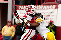 25 November 2011: Defensive back Jordan Bernstine #4 of the Iowa Hawkeyes interferes with at pass to wide receiver Kenny Bell #80 of the Nebraska Cornhuskers at the Memorial Stadium in Lincoln, Nebraska. Nebraska defeated Iowa 20 to 7.
