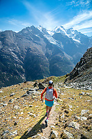 Trail running with the Dom in the distance, on the descent to Randa, while on the Via Valais, a multi-day trail running tour connecting Verbier with Zermatt, Switzerland.