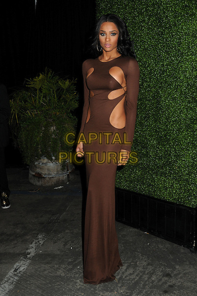 CIARA (Ciara Princess Harris).The Black Eyed Peas Present the 7th Annual Peapod Benefit Concert held at the Music Box Theatre, Hollywood, California, USA..February 10th, 2011.BEP full length brown long sleeve dress cut out away skin maxi.CAP/ADM/BP.©Byron Purvis/AdMedia/Capital Pictures.
