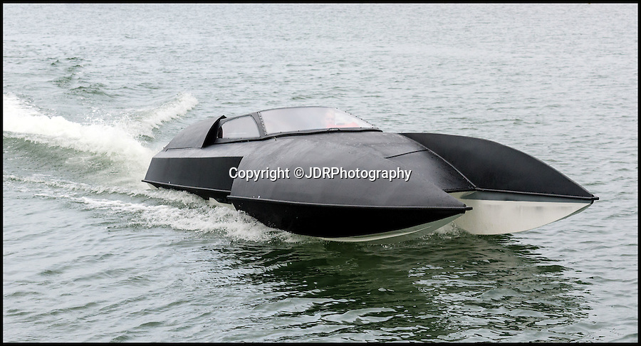 BNPS.co.uk (01202 558833)<br /> Pic: JDRPhotography/BNPS<br /> <br /> Boat out of hell - Bat boat built by boffin in a barn set's nautical pulses racing...<br /> <br /> A homemade boat which looks fit for Batman and is billed as the world's first luxury hydroplane is set to hit the market for £120,000. <br /> <br /> The 'bat boat' was the brainchild of 35-year-old engineer Chris Phillips who spent five years putting it together on his dad's farm. <br /> <br /> With a marine adapted 9.4 litre engine originally designed for American NASCAR racers, Chris spent £40,000 on producing the four-seat vessel which boasts 2,000 horse power can reach speeds of 60 knots. <br /> <br /> After selling his car so he could afford to take the prototype to display at the Southampton Boat Show, he says he has now attracted 'significant' investment to produce more.