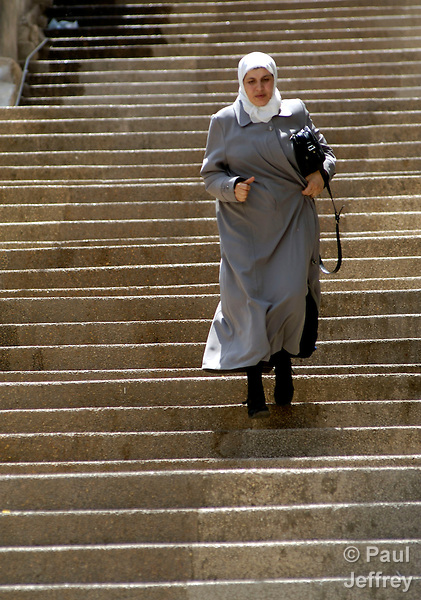 A Palestinian woman descends stairs in the West Bank city of Nablus.