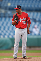 Louisville Bats relief pitcher Wandy Peralta (43) looks in for the sign during a game against the Syracuse Chiefs on June 6, 2016 at NBT Bank Stadium in Syracuse, New York.  Syracuse defeated Louisville 3-1.  (Mike Janes/Four Seam Images)