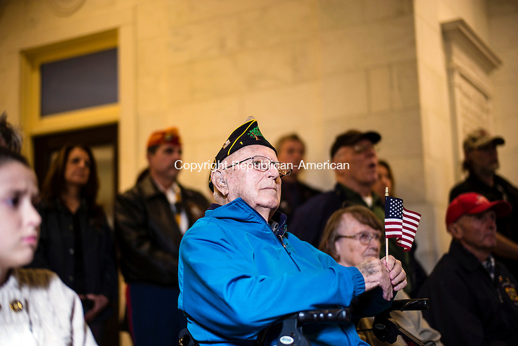 Waterbury, CT- 11 November 2016-111116CM05- Harry Raymond, from Waterbury and who served with the U.S. Navy holds onto an American flag during a Veterans Day ceremony at Waterbury City Hall on Friday.     Christopher Massa Republican-American