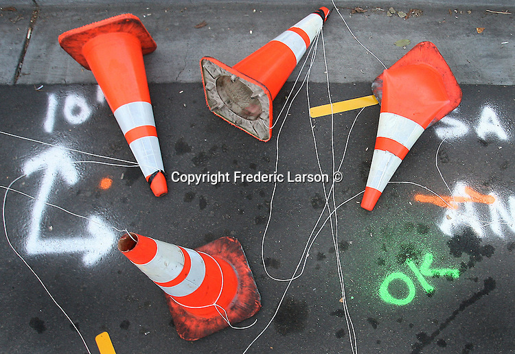 A melee of traffic cones were tipped over and placed in a artistic design in the streets of Sonoma County, California.