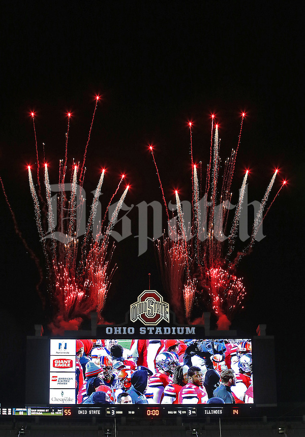 The scoreboard shows the final score of Ohio State 55 and Illinois 14 as fireworks go off at the end of the game  at Ohio Stadium on November 1, 2014. (Chris Russell/Dispatch Photo)