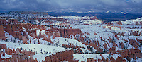 904000036 panoramic view of clearing winter storm that dropped large amounts of snow over the hoodoos in the silent city of bryce canyon national park utah