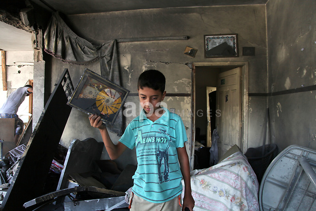 "Palestinian children inspect a damaged house was hit by an Israeli military strike in Gaza City on August 10, 2014. A senior Hamas official said there was a ""weak"" possibility that Gaza truce talks would succeed and that Palestinian negotiators could leave Cairo after a meeting with Egyptian mediators. Photo by Ezz al-Zanoun"