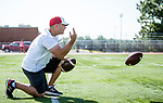 Wolcott, CT- 21 August 2017-082117CM02- Wolcott head coach of football, Matt Hove works with quarterbacks during practice drills in Wolcott on Monday.    Christopher Massa Republican-American