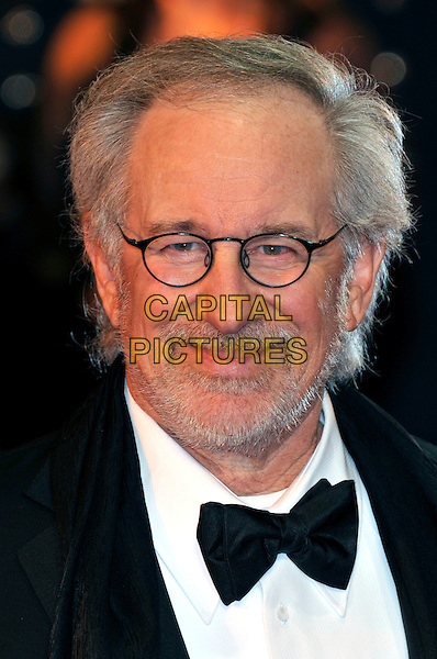 Steven Spielberg.UK Premiere of 'War Horse' at the Odeon, Leicester Square, London, England..January 8th 2012.portrait headshot glasses beard facial hair  bow tie black white shirt .CAP/PL.©Phil Loftus/Capital Pictures.