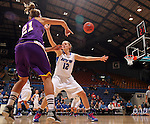 SIOUX FALLS, SD - MARCH 10:  Saule Kontautaite. #21 from Western Illinois passes the ball around Erin Murphy #12 from IPFW in the first half of their quarterfinal game Sunday afternoon at the 2013 Summit League Championships in Sioux Falls, SD.  (Photo by Dave Eggen/Inertia)