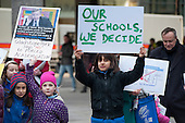 Parents and children from Gladstone Park Primary School in Brent join a teachers rally in Westminster called to protest at government policies on pensions, pay & conditions, academies and education cuts.