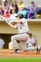 Mark Rhine #2 of the Wake Forest Demon Deacons attempts to lay down a bunt against the LSU Tigers at Alex Box Stadium on February 19, 2011 in Baton Rouge, Louisiana.  The Tigers defeated the Demon Deacons 4-3.  Photo by Brian Westerholt / Four Seam Images