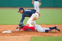 Chris McFarland #16 of Team Red slides head first into second base ahead of the tag by Tony Wolters #1 of Team Blue during the USA Baseball 18U National Team Trials at the USA Baseball National Training Center on June 30, 2010, in Cary, North Carolina.  Photo by Brian Westerholt / Four Seam Images