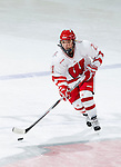 Wisconsin Badgers Lauren Unser (21) of the women's hockey team during a photo shoot. This was a staged action shot for the UW Marketing Department. (Photo by David Stluka)