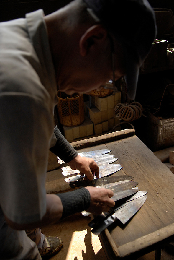 Laying out semi-finished knives in the Takahashi knife workshop. The company makes cooking knives for the shop in Tsukiji fish market.