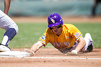 LSU Tigers shortstop Alex Bregman (8) dives back to first base during the NCAA College baseball World Series against the Cal State Fullerton on June 16, 2015 at TD Ameritrade Park in Omaha, Nebraska. LSU defeated Fullerton 5-3. (Andrew Woolley/Four Seam Images)