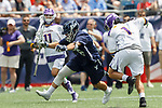Will Renz  (#16) works past Tehoka Nanticoke (#1) as Yale defeats UAlbany 20-11 in the NCAAA semifinal game at Gillette Stadium, May 26.
