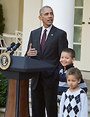 """United States President Barack Obama, left, joined by nephews Austin Robinson, 6, center, and Aaron   Robinson, 4, right, pardons the 2016 National Thanksgiving Turkey, Tater, and its alternate Tot, during a ceremony in the Rose Garden of the White House in Washington, DC on Wednesday, November 23, 2016.  This is the 69th anniversary of this honored tradition began in 1947 by President Harry S Truman.  Once pardoned the birds will be sent to their new home at Virginia Tech's Animal and Poultry Sciences Department at """"Gobbler's Rest"""" in Blacksburg, Virginia where they will be cared for by students and veterinarians.<br /> Credit: Ron Sachs / CNP"""