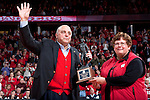 March 3, 2010: Wisconsin Badgers Chancellor Biddy Martin hands Athletic Director Barry Alvarez a trophy honoring his induction into the Rose Bowl Hall of Fame during a Big Ten Conference NCAA basketball game against the Iowa Hawkeyes on March 3, 2010 in Madison, Wisconsin. The Badgers won 67-40. (Photo by David Stluka)