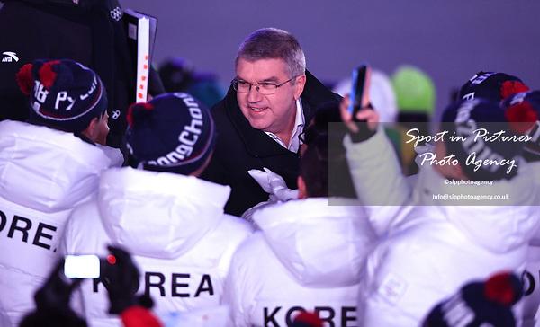 IOC president Thomas Bach speaks to some Korean athletes. Opening Ceremony. Pyeongchang2018 winter Olympics. Olympic stadium. Pyeongchang. Republic of Korea. 09/02/2018. ~ MANDATORY CREDIT Garry Bowden/SIPPA - NO UNAUTHORISED USE - +44 7837 394578