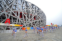 Aug. 8, 2008; Beijing, CHINA; Volunteers walk in front of the National Stadium prior to the start of the opening ceremonies for the 2008 Beijing Olympic Games. Mandatory Credit: Mark J. Rebilas-