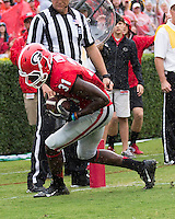 The Georgia Bulldogs played North Texas Mean Green at Sanford Stadium.  After North Texas tied the game at 21 early in the second half, the Georgia Bulldogs went on to score 24 unanswered points to win 45-21.  Georgia Bulldogs wide receiver Chris Conley (31) beats North Texas Mean Green defensive back Zac Whitfield (23) for a touchdown pass reception.