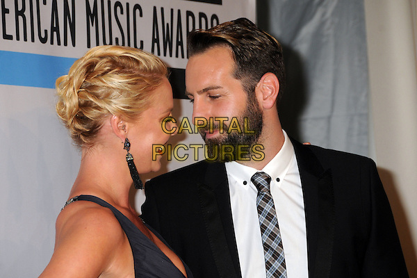 Katherine Heigl and Josh Kelley.2011 American Music Awards - Press Room held at Nokia Theatre LA Live, Los Angeles, California, USA..November 20th, 2011.ama amas ama's headshot portrait black grey gray hair up twists twisted earrings profile suit beard facial hair married husband wife.CAP/ADM/BP.©Byron Purvis/AdMedia/Capital Pictures.