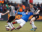 Maurice Edu wins the ball from Gary Mason and Martin Hardie