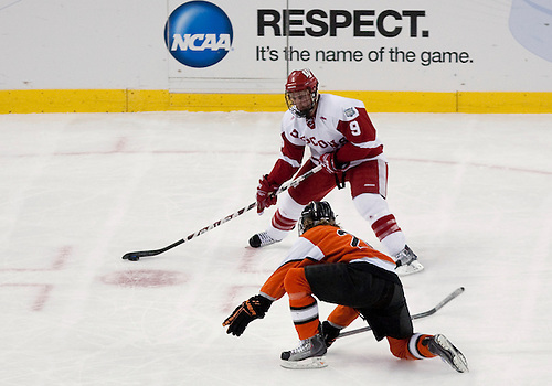 08 April 2010: Wisconsin Forward Michael Davies (#9) makes move on RIT defensemman in game action between the Wisconsin Badgers and the Rochester Institute of Technology (RIT) Tiger at Ford Field in Detroit, Michigan.  Wisconsin defeated RIT 8-1. Mandatory Credit: John Mersits / Southcreek Global