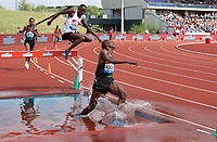 Benjamin Kigen of Kenya lands awkwardly as winner Conseslus Kipruto of Kenya chases him down during the Men's 3000m Steeplechase at the Muller Grand Prix  IAAF Diamond League meeting at Alexander Stadium, Perry Barr, Birmingham.<br /> Picture by Alan Stanford +44 7915 056117<br /> 18/08/2018