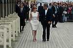 Jessica Chastain arrives with the mayor of the city on the Promenade des Planches on September 5, 2014 in Deauville, France