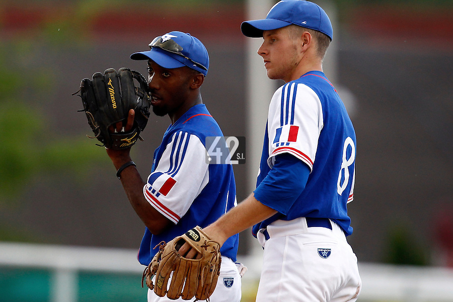 22 June 2011: Felix Brown of Team France talks to Gregory Cros during AIST Alumni 5-3 win over France, at the 2011 Prague Baseball Week, in Prague, Czech Republic.